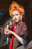 Russian girl in a kokoshnik Royalty Free Stock Images