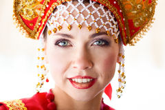 Russian girl in a kokoshnik. Portrait of a Russian girl in the headdress, girl smiling Stock Photography
