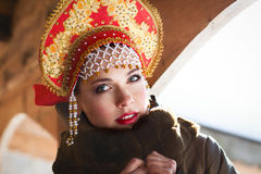 Russian girl in a kokoshnik. Russian girl in the village Royalty Free Stock Images