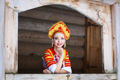 Russian girl in a kokoshnik. Russian woman in a kokoshnik a smiling in a village stock photography