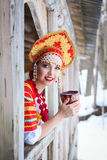 Russian girl in a kokoshnik. Russian woman in a kokoshnik a smiling in a village Royalty Free Stock Photo