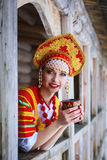 Russian girl in a kokoshnik. Russian woman in a kokoshnik a smiling in a village royalty free stock image