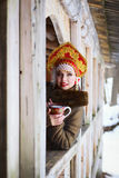Russian girl in a kokoshnik. Russian woman in a kokoshnik a smiling in a village Royalty Free Stock Photography