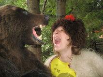 Russian girl with large bear. Russian girl in a cap with a rose Royalty Free Stock Photography