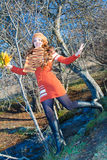 Russian girl with leaves running on nature Royalty Free Stock Image
