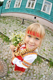 Russian girl in national costume with bagels and flowers Stock Images