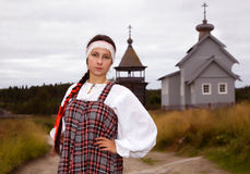 Russian girl in national dress Stock Photos
