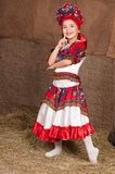 Russian girl in national dress. Young girl in Russian national costume dancing to the music Stock Image