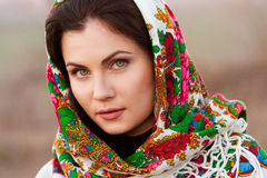 Russian girl in national headscarves Stock Photos