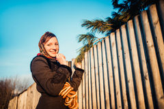 Russian girl in national headscarves near wooden Stock Photos