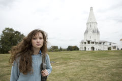 Russian girl near russian cathedral. Stock Photo