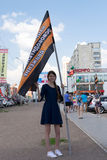 Russian Girl at a NOD Political Meeting in Ufa. Young girl supporter of NOD in Ufa Russia celebrating with a national flag in Ufa Russia May 2015 stock photos