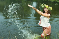 Russian girl in river Stock Images