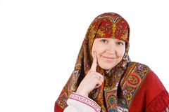 The Russian girl in a scarf smiles. The Russian girl in a national scarf smiles Royalty Free Stock Images