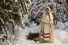 Russian girl with a sled in the winter woods Royalty Free Stock Photo