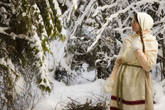 Russian girl with a sled in the winter woods Stock Image