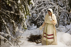 Russian girl with a sled in the winter woods Royalty Free Stock Photos