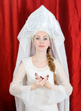Russian girl in traditional costume. And kokoshnik royalty free stock photography