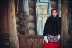 Russian girl in the village Stock Photography