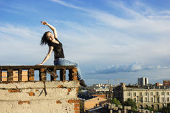 Russian girl walking on the roof. Brave girl walking on the roof of Saint-Petersburg Royalty Free Stock Photography