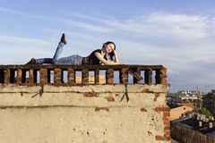 Russian girl walking on the roof Stock Image