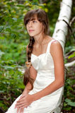 Russian girl in white dress in a birch forest Royalty Free Stock Photos