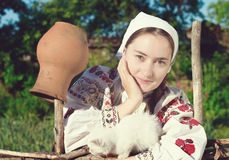 Russian girl  with white kitten Stock Photography