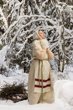 Russian girl in the winter woods Royalty Free Stock Photography