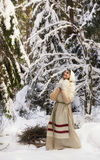 Russian girl in the winter woods Royalty Free Stock Photo