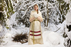 Russian girl in the winter woods Royalty Free Stock Photos