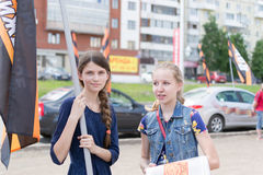 Russian Girls at a NOD Political Meeting in Ufa. Two young girl supporters of NOD in Ufa Russia celebrating with a national flag in Ufa Russia May 2015 stock photography