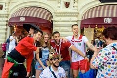 Russian girls photographed with fans of the Moroccan football team stock photo