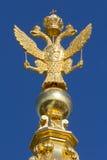 Russian golden double headed eagle. The russian national symbol, a double headed eagle, in gold in Peterhof, St. Petersburg, Russia stock photos