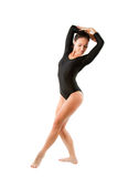 Russian gymnast in sports swimsuit makes exercise Royalty Free Stock Image