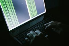 Russian hacker hacking the server in the dark Royalty Free Stock Images