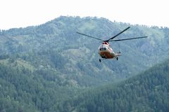 Russian helicopter MI-8 flies stock photography