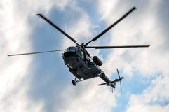 Russian helicopter MI-17 in the sky over Moscow on a background of clouds Stock Photos