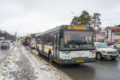 Russian hinterland and modern bus rides on the highway in winter Royalty Free Stock Photos