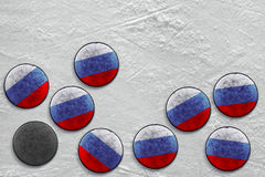 Russian hockey pucks. Washers lying on a hockey rink. Texture, background Stock Photos