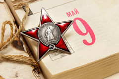 Russian holiday - the Day of Victory in the Great Patriotic War,. Order of the Red Star on the calendar on the Victory Day / Russian translation of the words in Royalty Free Stock Images