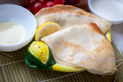 Russian Hot Pancakes. Hot Pancakes with sourcream on the lemon-plate Royalty Free Stock Image