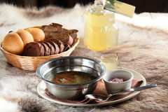 Russian hot soup with bread and home alcohol Stock Photos