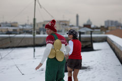 Russian ice skating stars in characters of Karlsson-on-the-roof. St. Petersburg, Russia - November 25, 2015: A. Yagudin (Karlsson) and M. Petrova (Lillebror) in Royalty Free Stock Photos