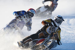 Russian Ice Speedway Championship. Novosibirsk, Russia - December 20, 2014: Unidentified bikers during the semi-final individual rides of Russian Ice Speedway Royalty Free Stock Photo