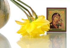 Russian icon of Virgin Mary and daffodils in round. Russian Orthodox icon of Virgin Mary, reclining daffodils in round vase Stock Photography