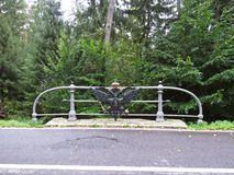 Russian Imperial Coat of Arms Double Headed Black Eagle with Golden Crowns on the Bridge Railing representing Alexander Third, royalty free stock photography