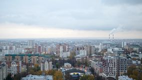 Russian industrial district - aerial panorama of autumn city in cloudy sky stock video