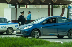 Russian inspector-the policeman on the highway. Policemen from traffic police monitor violations of traffic rules and often patrolled the streets of towns and stock photography