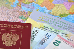 The Russian international passport, euro and the Lithuanian simplified transit document by rail (UPD ZhD) lie on the pol Royalty Free Stock Photo