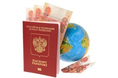 Russian International passport with money, globe and origami pla. Ne made from money isolated on white background Stock Photo